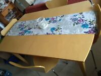 Extending table and four chairs for sale