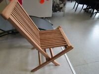 two sold hardwood deck chairs