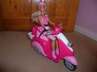 Barbie doll and pink Vespa Scooter