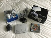 PlayStation One with two controllers and Crash Bandicoot game, complete with original boxes.