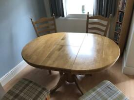 Solid oak round extendable table with 6 chairs