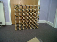 Matching wine racks made of redwood for holding 30 bottles each. Excellent condition. 2 available.