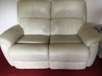 2 2 seater reclining leather sofas with matching stool £300 or nearest offer