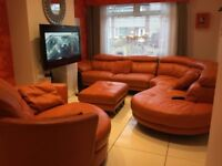 Large leather sofa , chair and footstool