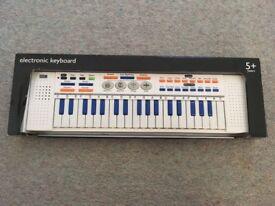 Children pianola/musical keyboard