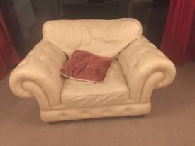 4 piece cream leather Chesterfield with scatter back cushions.