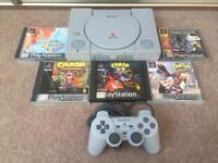 PlayStation 1 console with Crash Bandicoot 1,2 & 3