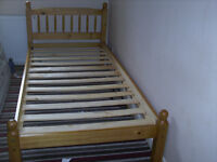 TWO PINE SINGLE BEDS SELDOM USED .....................................................£100