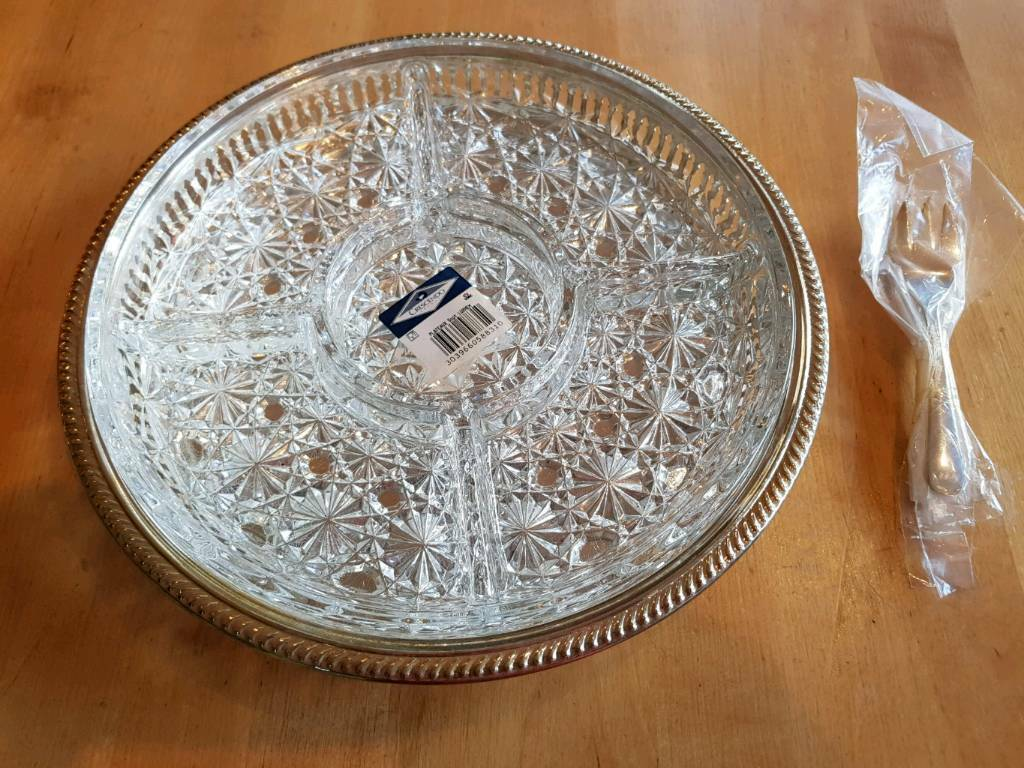 Silver-plated and glass serving platter and forks