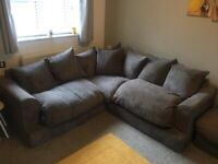 Grey sofa with foot stool/pouffe
