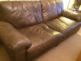Brown leather Italian made settee. Good condition.