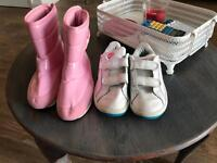 Two pairs of Nike kids shoes