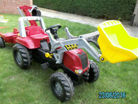 Rolly Toys ride-on tractor with trailer and front and rear diggers