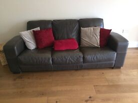 Three seater leather sofa with cushions