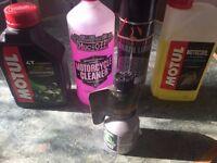 Motul 10w 40 oil/coolant /chain lube/restorer aditive
