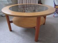 Solid teak circular glass coffee table excellent condition.
