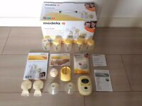 Medela freestyle double breastpump + NEW Calma teat + 5 bottles