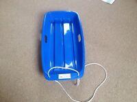 "Blue plastic sledge - new, unused, 33"" long approx"