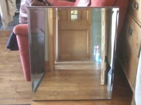 Large bevelled mirror on wooden backing,used
