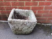 Weathered concrete garden planter pot