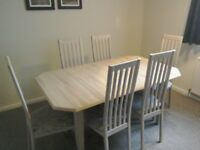 Extended limed oak effect dining table & matching 6 chairs. All in excellent condition. Uplift only.