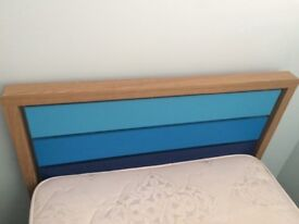 Wooden single bed for sale.
