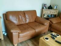 Large 2 and 3 seater tan leather sofas with matching storage pouffe