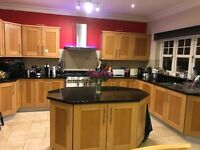 Large Kitchen shaker style with black granite worktops and island