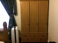 triple wardrobe and drawers, 2 wardrobes and a single wardrobe joined together sits on 5 drawers