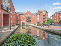 Unique 2 bed canal side renovated garden flat & parking in superb Piccadilly Village, central M/cr