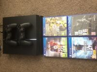 PlayStation 4 with 2 controllers and 4 games