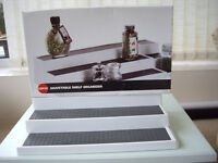 """2 Copco adjustable kitchen shelf/cupboard organizers,one boxed,one not. Adjusts from 15"""" to 28"""" wide"""