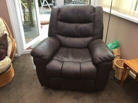 Brown leather manual recliner armchair. Very comfortable