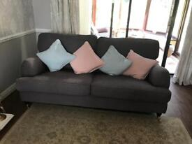 Debenhams grey feather filled sofa x 2 and footstool