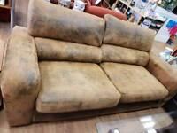 Large 2 seater suede sofa in a mottled design in dark biege black