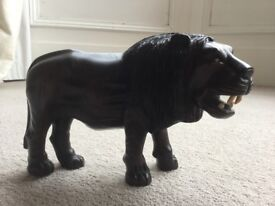 Carved African lion - solid hardwood from Zambia