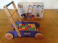 Tidlo baby walker with complete set of blocks in very good condition, retails at £44.99.