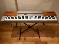 Yamaha stage piano p120 weighted keys stand and pedal.