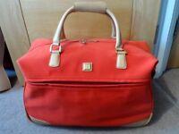 Diane von Furstenberg red travel bag suitcase. Handle.Wheels.