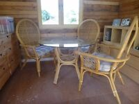 Bamboo Cane Glass topped table with 3 large chairs