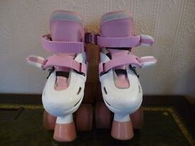 Girls Pink and White Roller skates with light up wheels adjustable sizes from 8J to11J