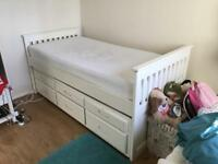 White single bed with pull out guest bed and three drawers with two mattresses