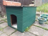 Large dog house free. Needs to be dismantled before taken away. Green paint included.