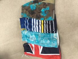 4 pairs boys swimming shorts . Age 11 years