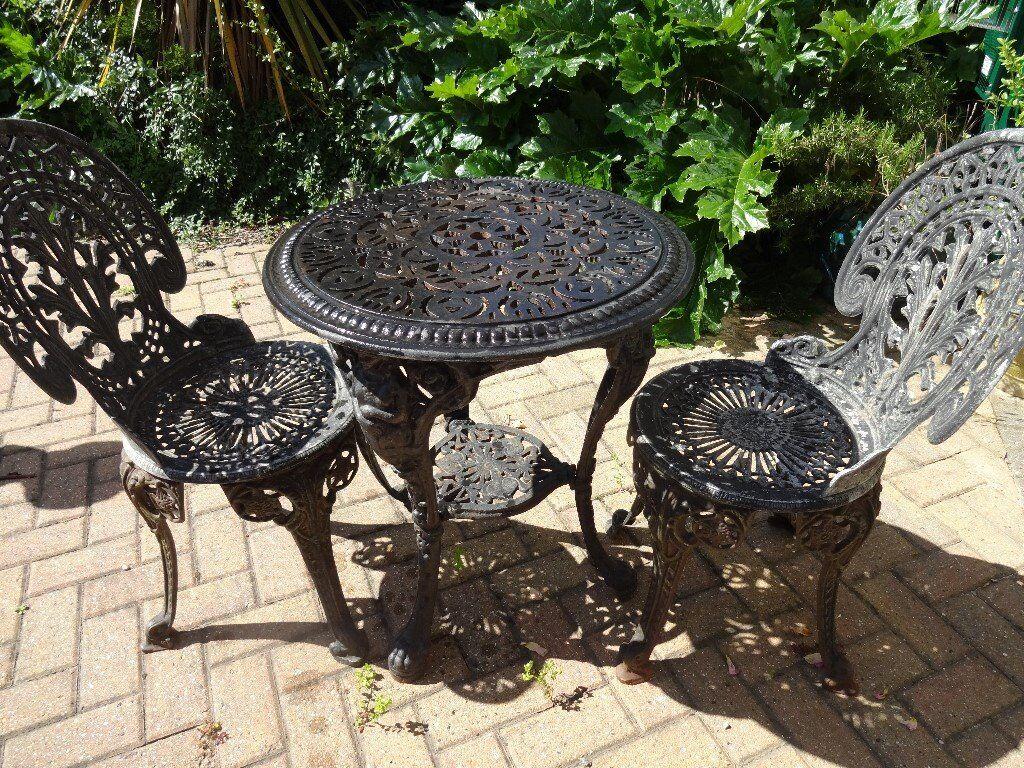 "CAST IRON GARDEN SET -- ""BRITANNIA "" TABLE AND 2 CAST IRON ..."