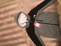 North face zip top. Large boys. New with tags. REAL. Never worn