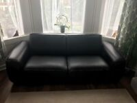 1 Year Old Faux Black Leather Sofa - Barely Used Due to Frequent Travelling