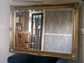 """Traditional style gold framed mirror. 42"""" x 30"""""""