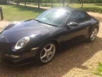 PORSCHE 911 CARRERA CABRIOLET FULL OPTIONS TIPTRONIC AUTO 49K MILS FSH BLACK SUPERB CONDITION.
