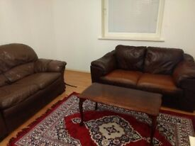 2+2 seater sofa with center table. Sofa in good condition .